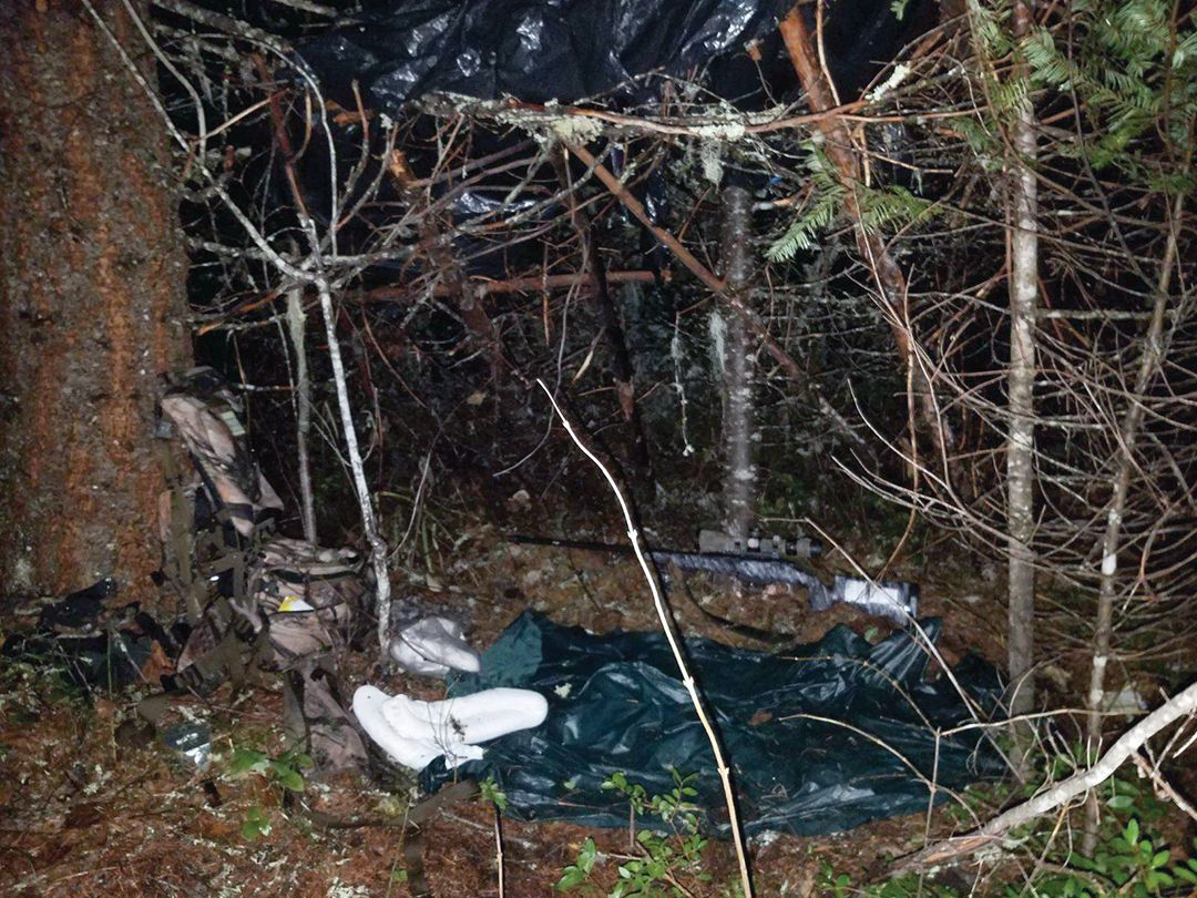 An overnight shelter was fabricated from sticks and two large garbage bags Freeman carries for emergency rain cover. Elk bags were used as pillows.