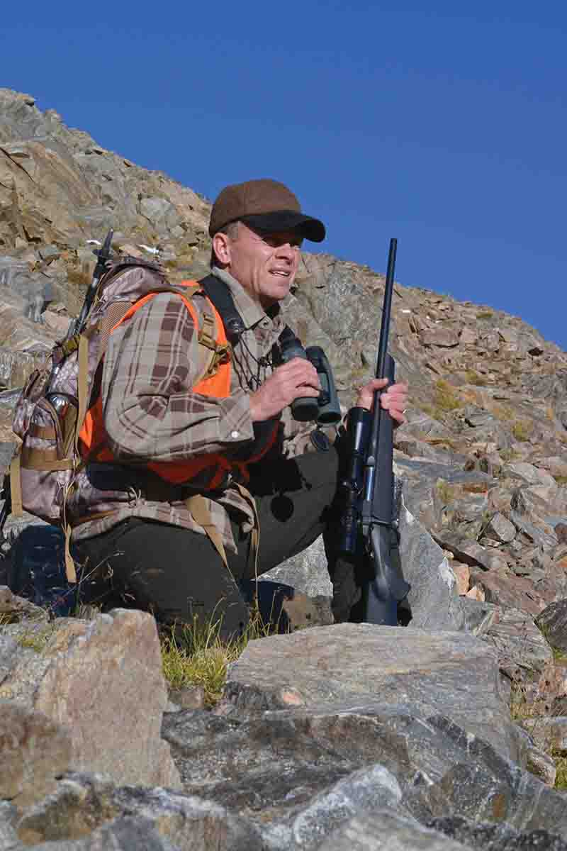 Jack is shown glassing from a scree slope at 10,000 feet. Muleys can be found at very high elevations in early autumn.