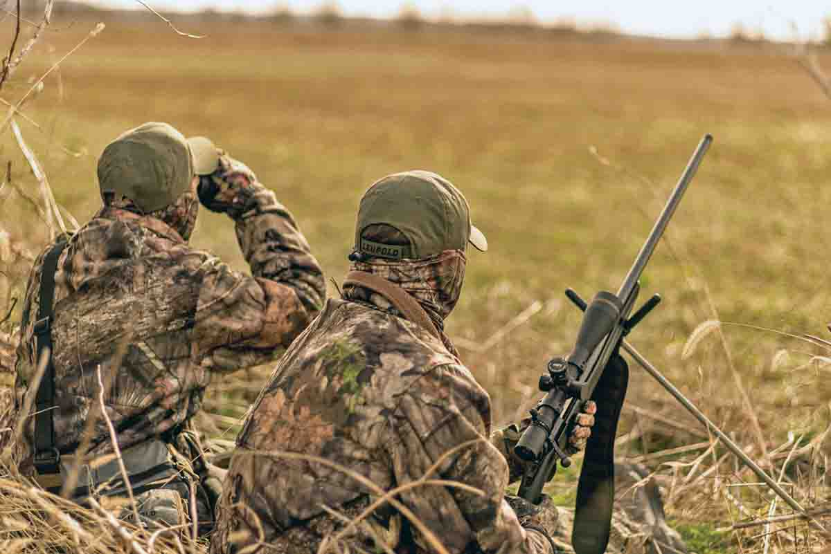 Two hunters means two sets of eyes, two guns and shared predator-hunting experience.  Photo courtesy Howard Communications