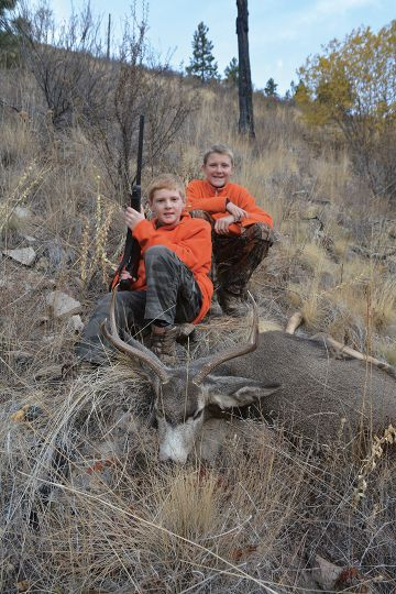 A young hunter often decides if he or she will continue to hunt depending on previous success. Here Jason's youngest son Ryan has filled his buck tag – a new hunter is born.