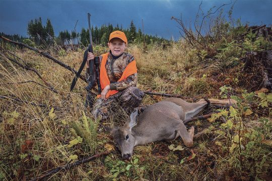 Ryan found this blacktail doe after he hiked a ridgeline along a clear-cut and made the shot – without any guidance from his father.