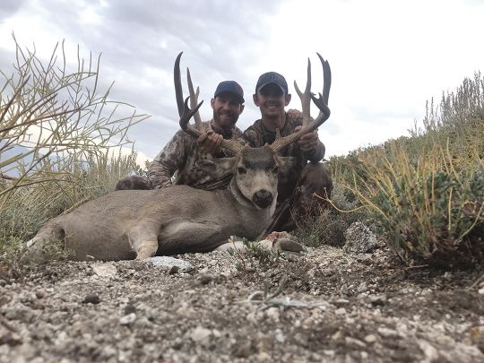 Tyler Dennison (right) and his hunting buddy Cody Darling show off the tremendous X9b Inyo mule deer shot on opening day of the 2017 California deer season after more than two months of backcountry scouting.