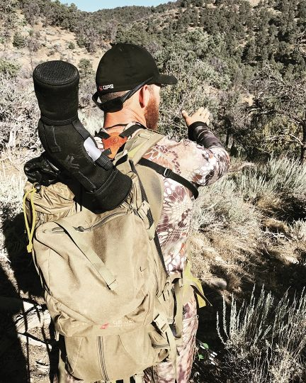 Cody Darling points out what he thinks might be the best route to use to get in on the big buck after it was spotted opening morning. The hunters abandoned three stalks when deer in the group with the big buck got edgy. The fourth stalk was the charm.