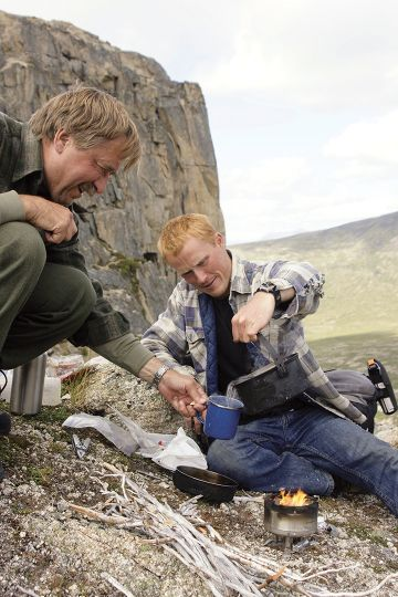 On a mountain in the Yukon, Terry (left) and Leif Austad, Dall sheep stalker extraordinaire, brewed up some lunch on the little Sierra stove.