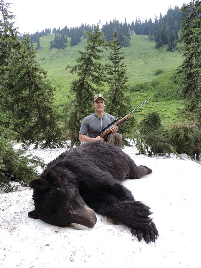 After taking cover from a lightning storm, Joel takes time out to admire a beautiful bear shot on public land.