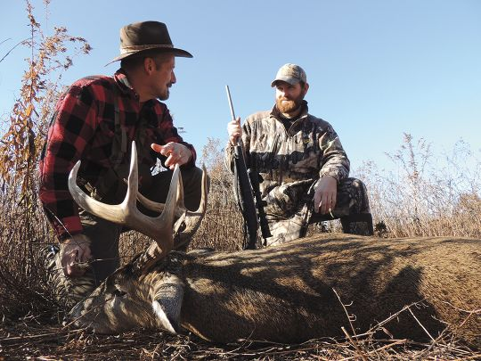 Gary tagged this 8-point whitetail while hunting with Levi Mallory (right) on the family farm in Missouri.