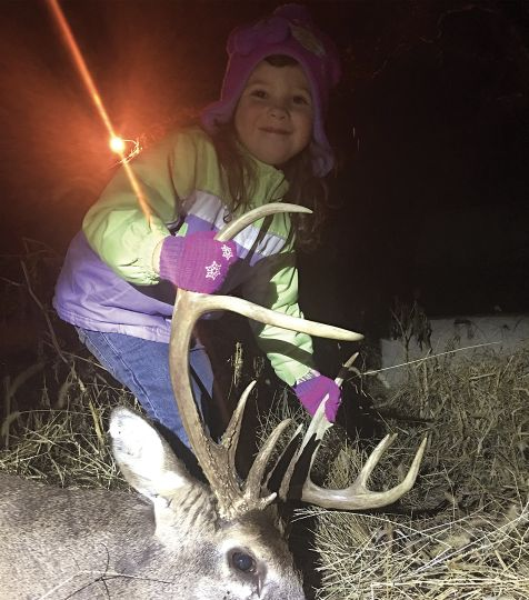 Four-year-old Elizabeth poses with the buck her grandmother tagged on the second afternoon of the season.