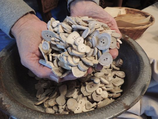 A handful of buttons that Nancy Mallory makes from her hunting trophies and antler sheds found on the farm.