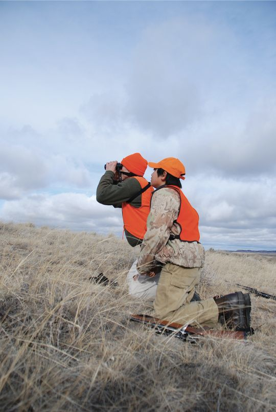 Jack and his son keep tabs on a mule deer herd at midday.