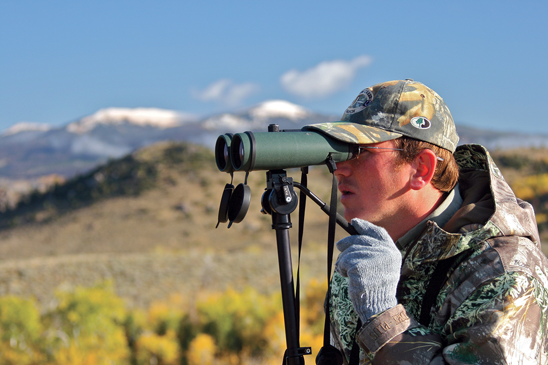 A tripod-mounted binocular provides a steady platform for glassing the wide expanses of the West.