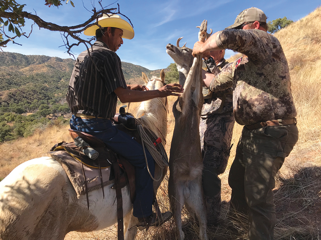 One of the ranch cowboys was able to ride his horse right to the downed buck for a quick retrieval.