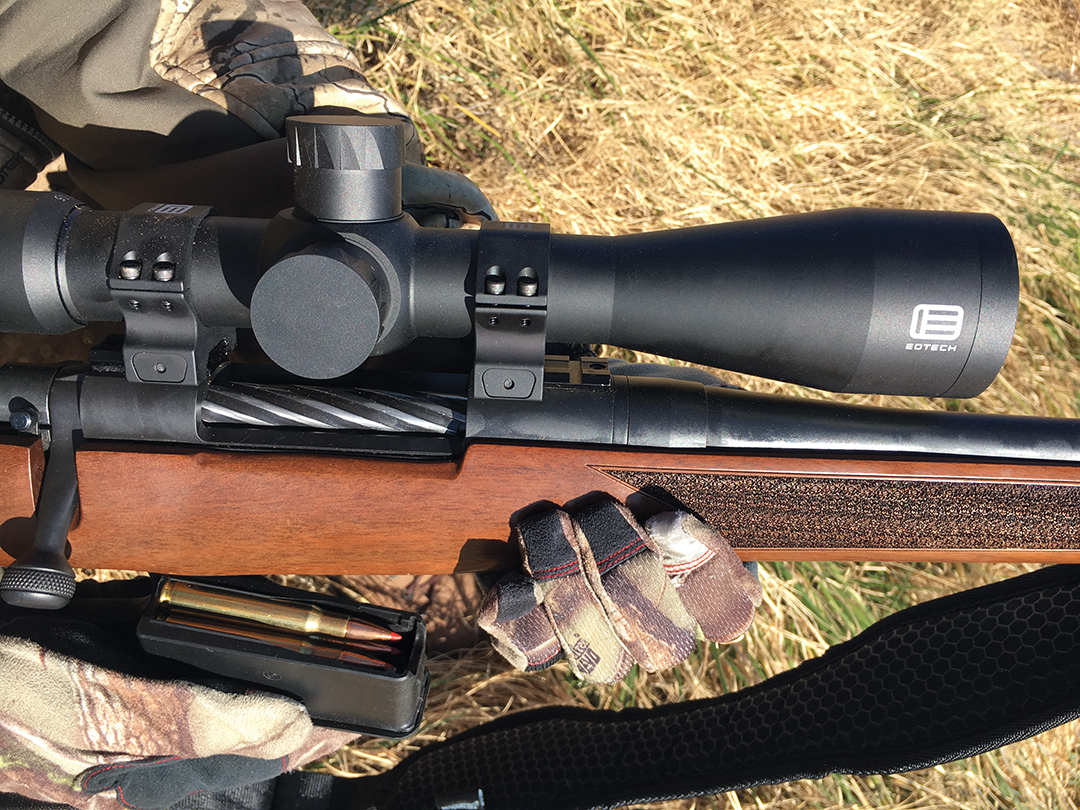 Hot weather hunting often means shooting in low light, where a scope that transfers a lot of light stands out. The rifle is a Mossberg Patriot .30-06 with an EOTech Vudu 3-18x 50mm SFP scope, and the ammunition is Hornady's Full Boar 165-grain GMX.