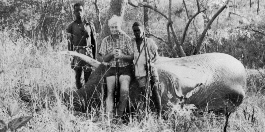 "This is a very rare photo of John ""Pondoro"" Taylor (center), who hunted elephant indiscriminately."