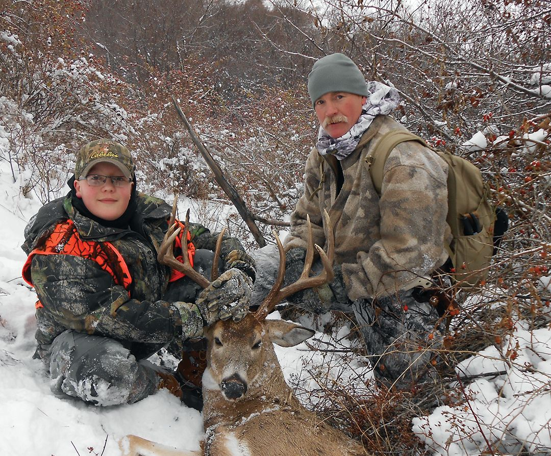 Mike and his hunting buddy Dan Clark guide and mentor young hunters and anglers year-round.  This young hunter took his first buck with Mike in 2013.